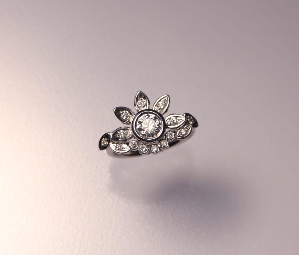 Bague en or blanc et diamants création Lausanne